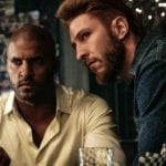 Starz's 'American Gods' has some major behind the scenes drama happening. Here's the story on accusations of racism, firings, and the show's third season.